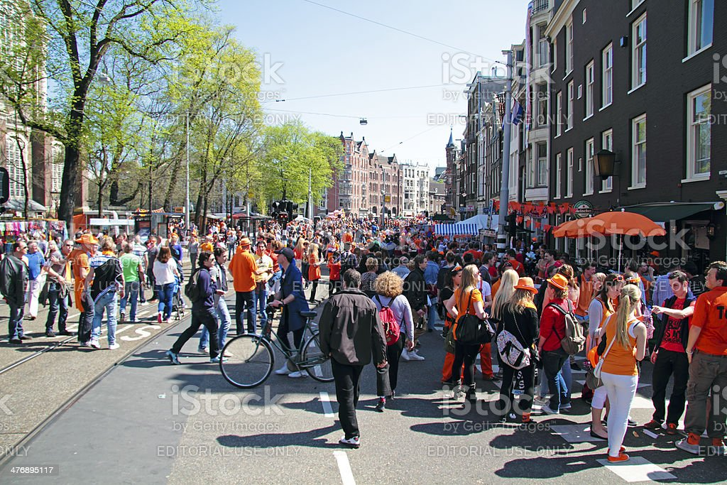 Big orange crowds partying in Amsterdam Netherlands stock photo