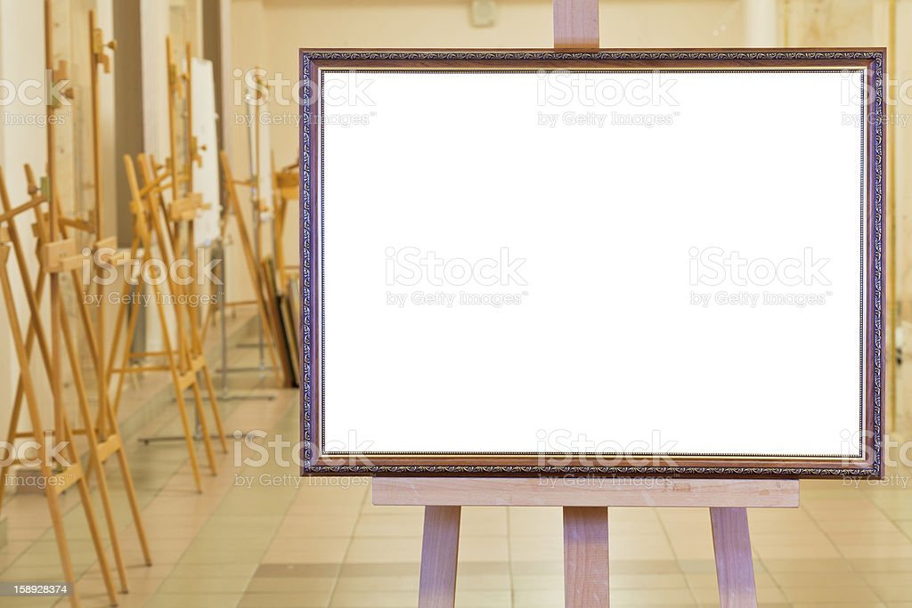 big picture frame on easel in gallery hall royalty-free stock photo
