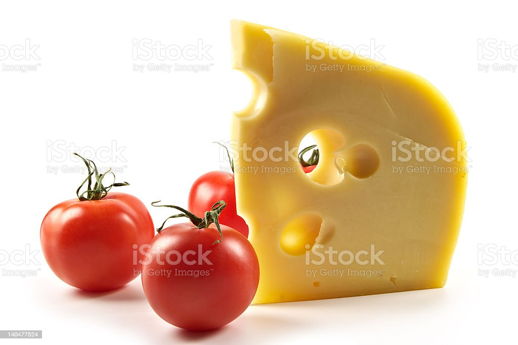 Big piece of fragrant elite cheese and tomatoes royalty-free stock photo
