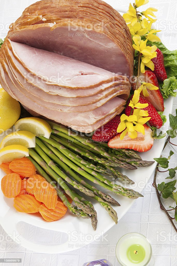 Big piece of ham with vegetables and fruit on white plate royalty-free stock photo