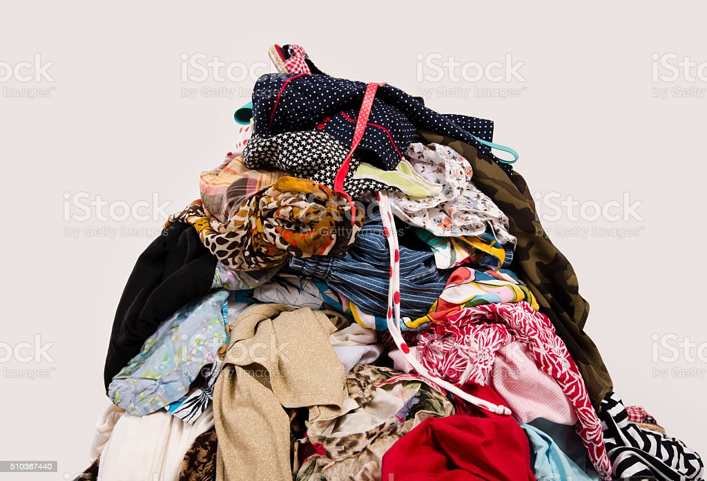 Big pile of clothes and accessories thrown on the floor. stock photo