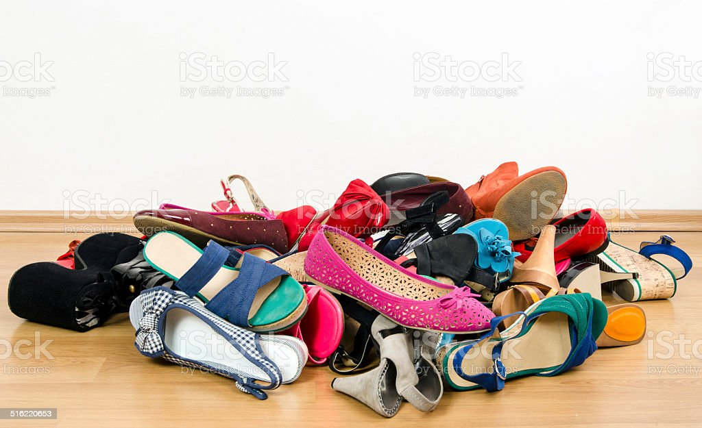 Big pile of colorful woman shoes. stock photo