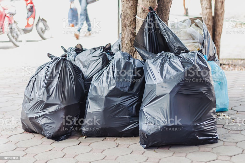 Big pile of garbage and waiste in black bags stock photo