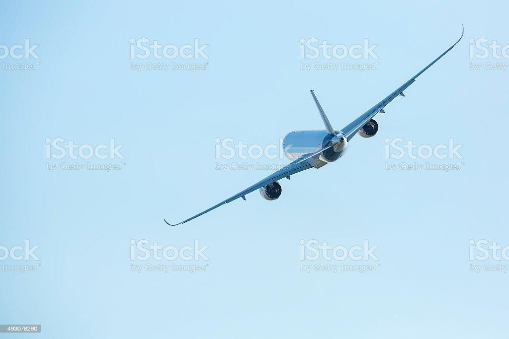 Big plane in the blue sky. stock photo