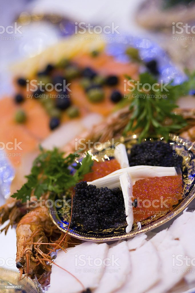 Big plate with red and black caviar  at russian restaurant. royalty-free stock photo