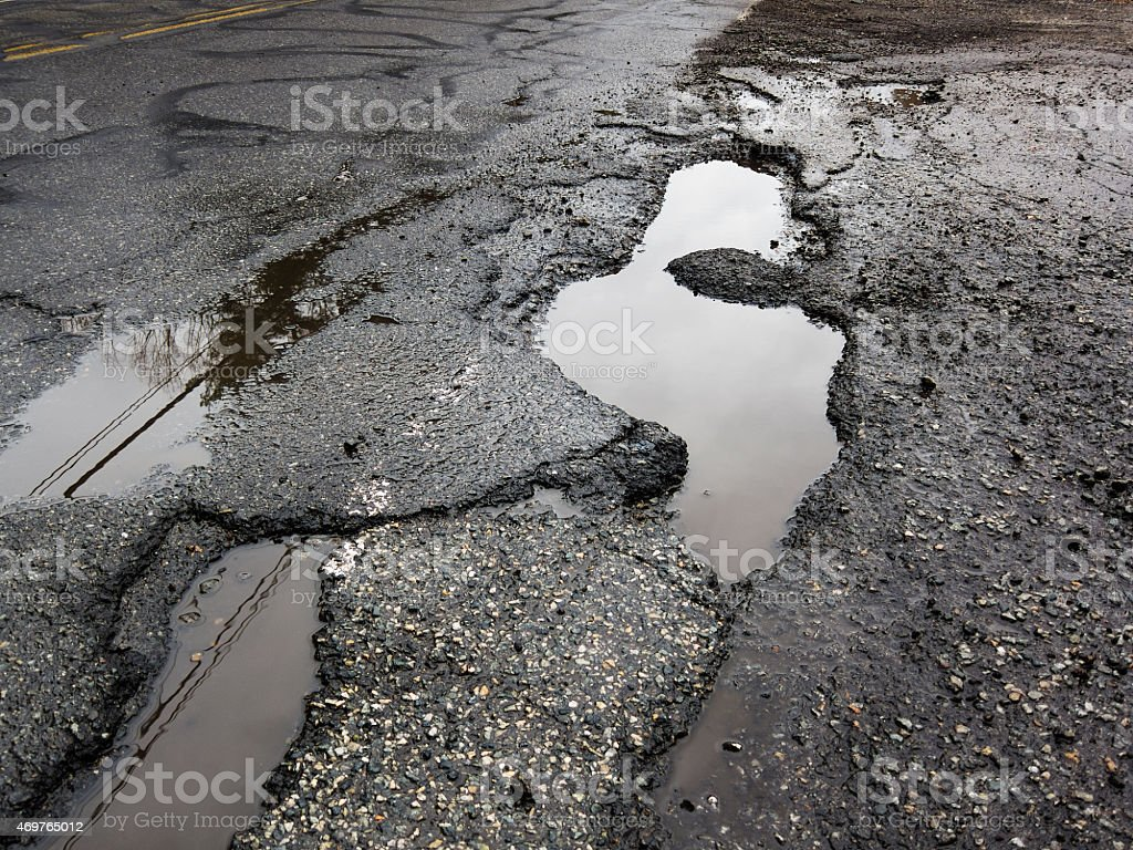 Big pothole in road stock photo