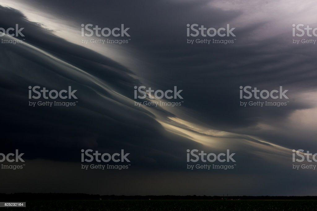 Big powerful storm clouds and stormy sky stock photo