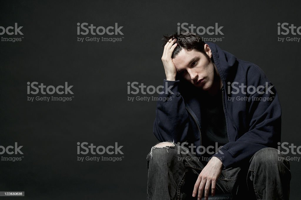 Big Problem, Serious and Depressed Teenager in Black Clothing stock photo