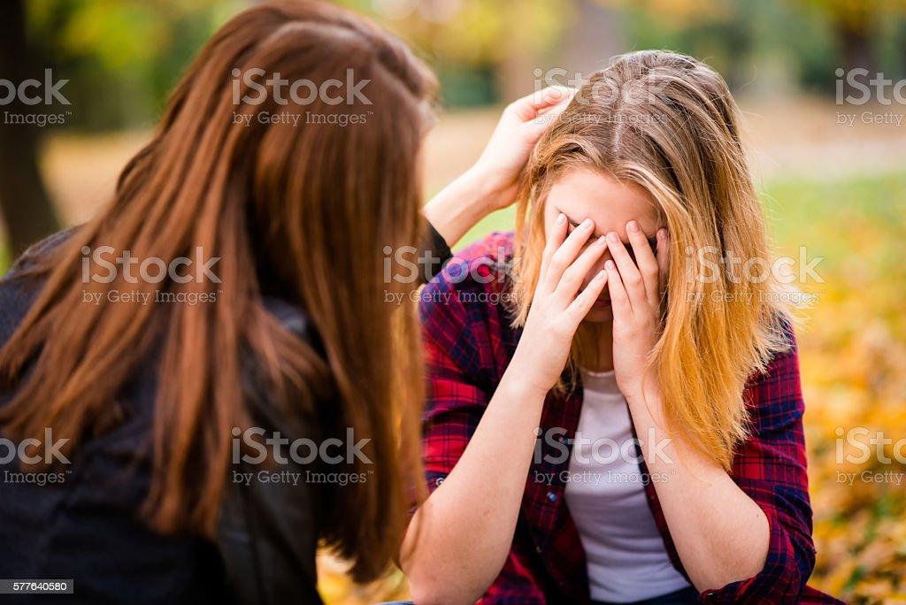 Big problem - talk with friend stock photo