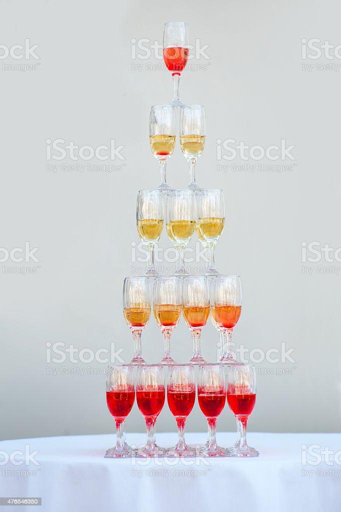Big pyramid of wineglasses stock photo