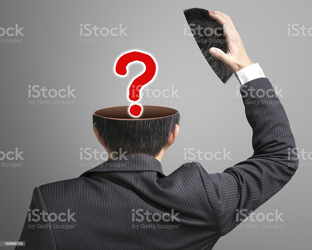 Big question mark pop out businessman head in gray background stock photo