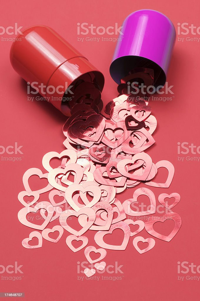Big Red and Pink Pill Spills Shiny Valentine Hearts stock photo