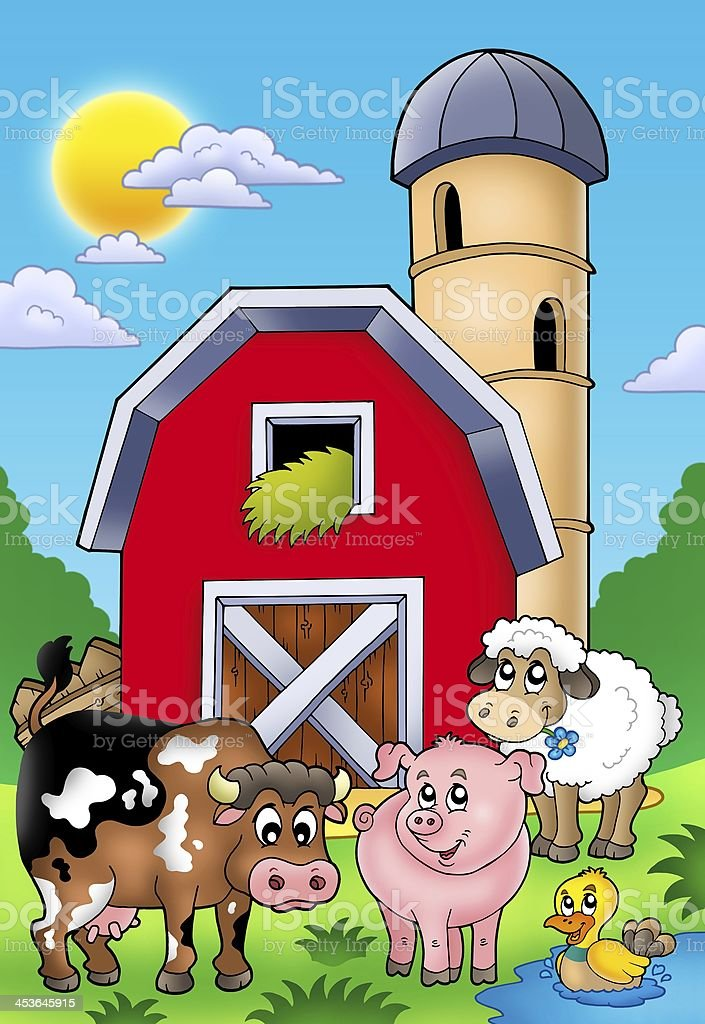Big red barn with farm animals stock photo