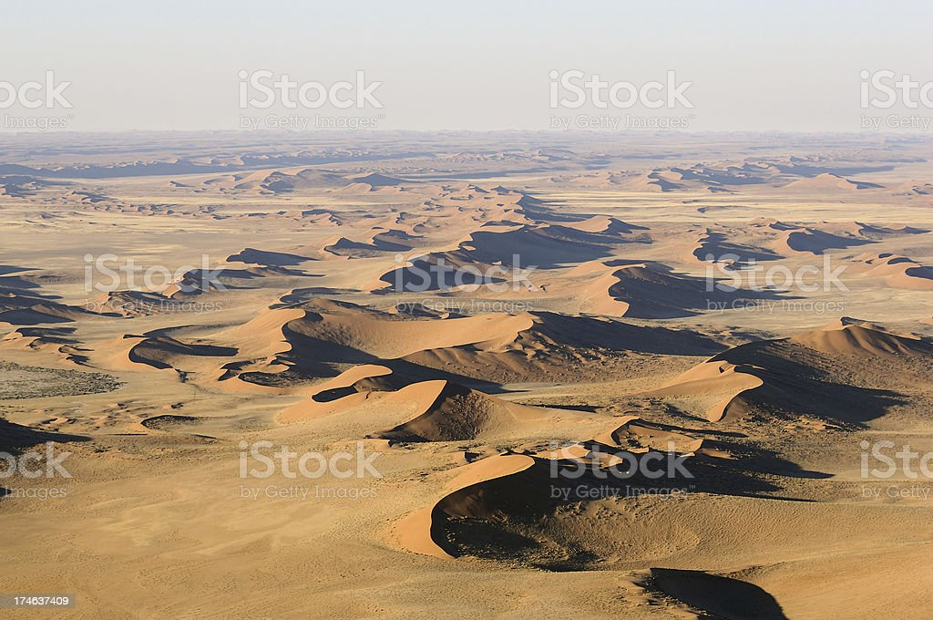 Big red dunes in the morning mist stock photo