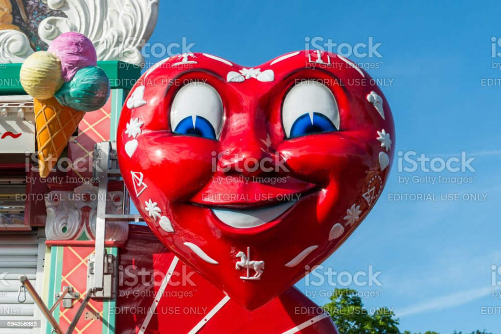 Big red heart at a candy bar at a folk festival stock photo