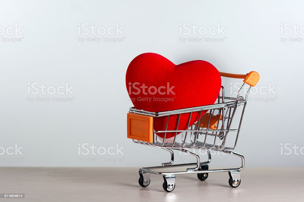 Big red heart in a shopping cart. stock photo