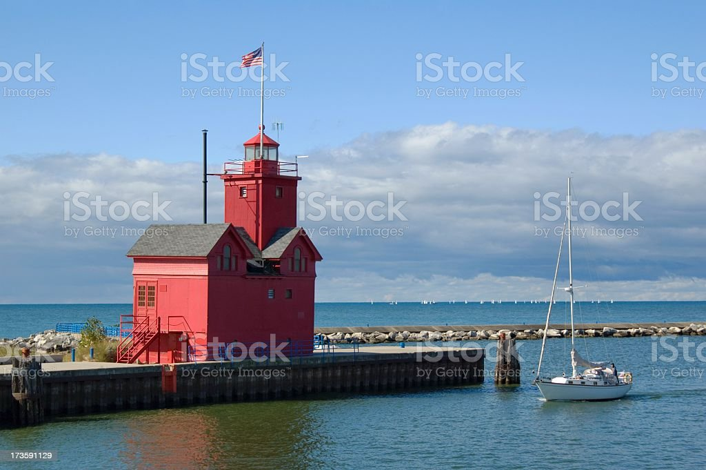 Big Red Lighthouse in Holland and Yacht royalty-free stock photo