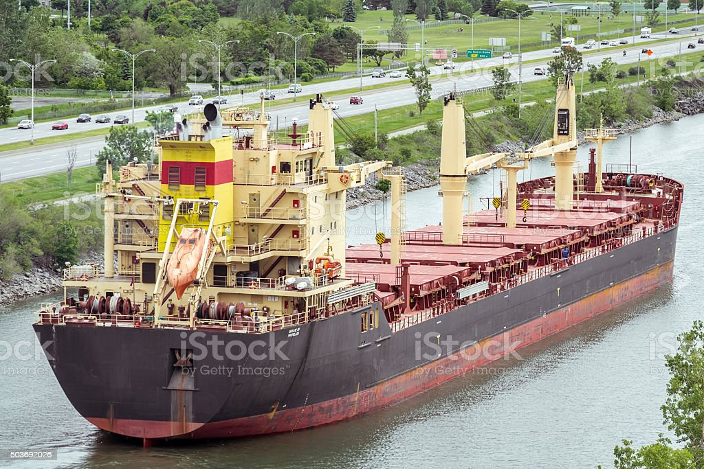 Big red-black tanker on Maritime route in Montreal stock photo