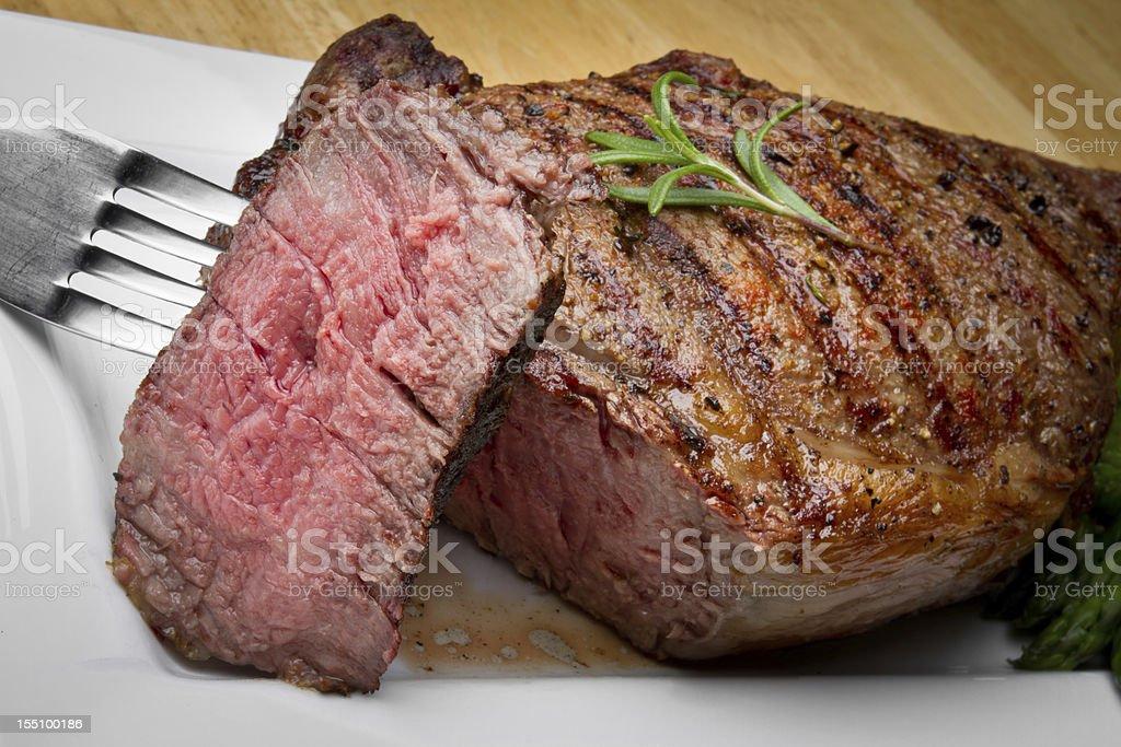 Big Rib Eye Beef Steak With Bite Cut Out stock photo