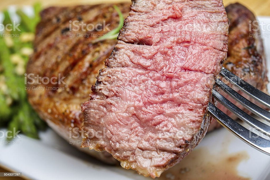 Big Rib Eye Beef Steak With Bite Cut Out stock photo