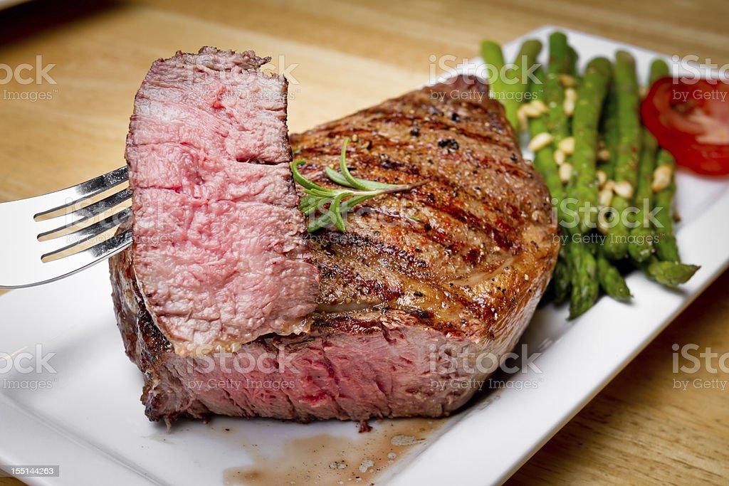 Big Rib Eye Steak With Bite Cut Out stock photo