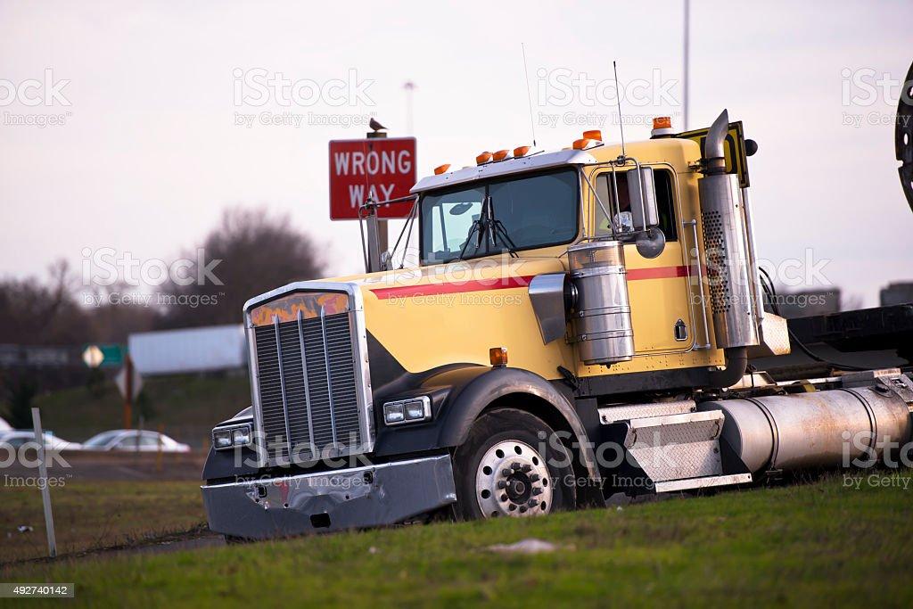 Big Rig semi-truck classic pass sign wrong way stock photo