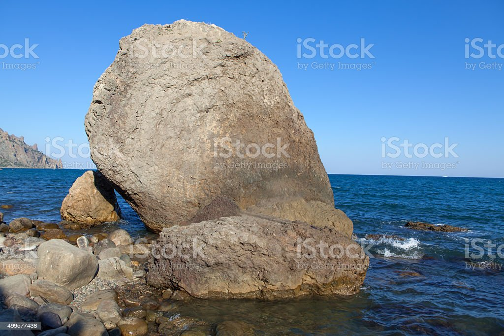 big rock in the sea stock photo