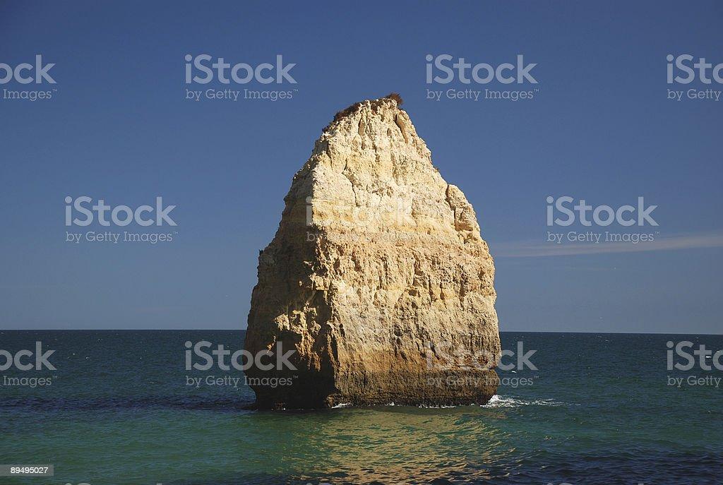 Big rock in water stock photo