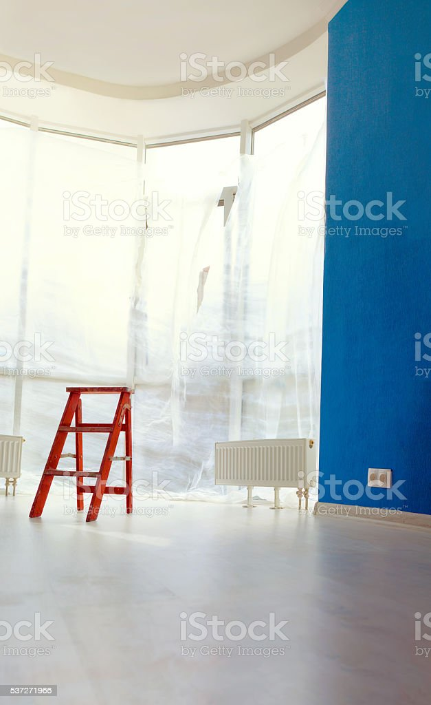 Big room wooden ladder on  background windows stock photo
