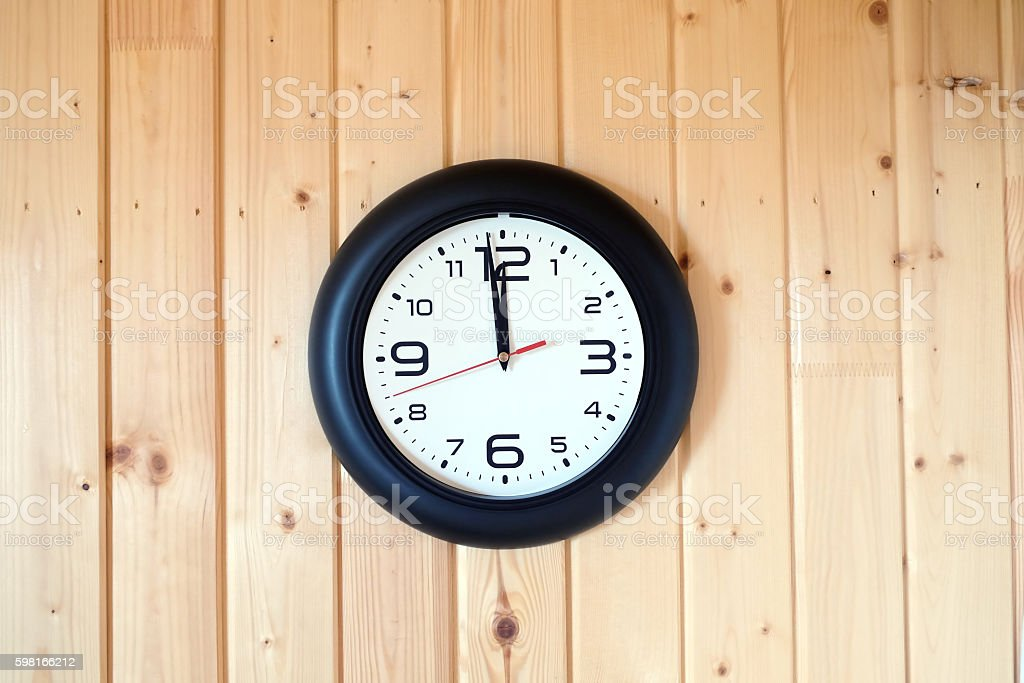 Big round wall clock on wooden background stock photo