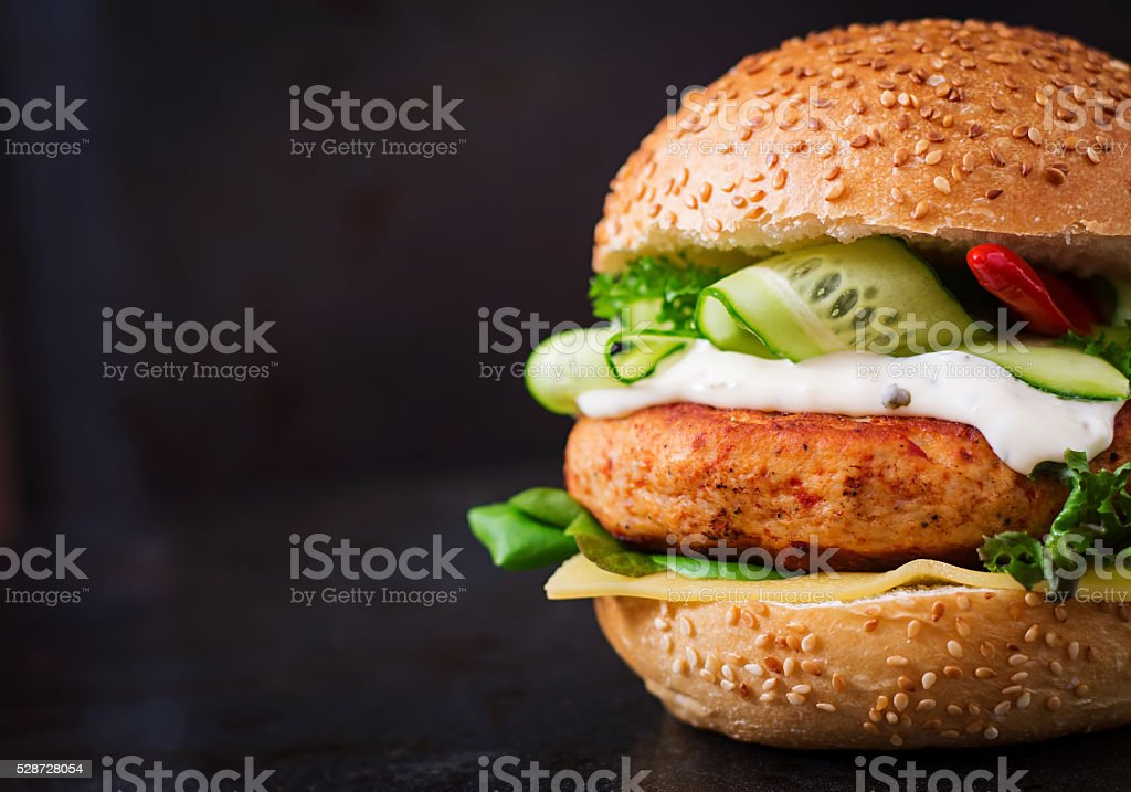 Big sandwich - hamburger with juicy chicken burger stock photo