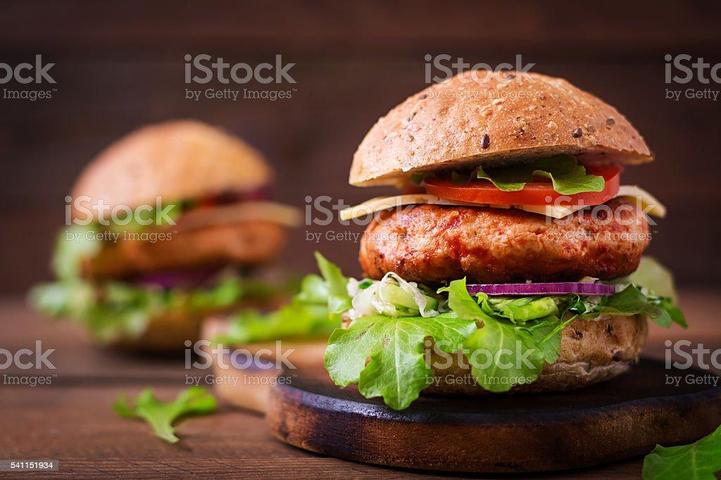 Big sandwich - hamburger with juicy chicken burger stock photo