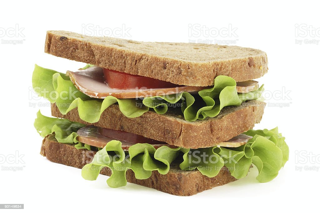 Big sandwich with brown  bread  on white background royalty-free stock photo