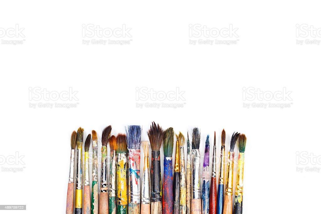 Big set of artist dirty paint brushes on white background stock photo