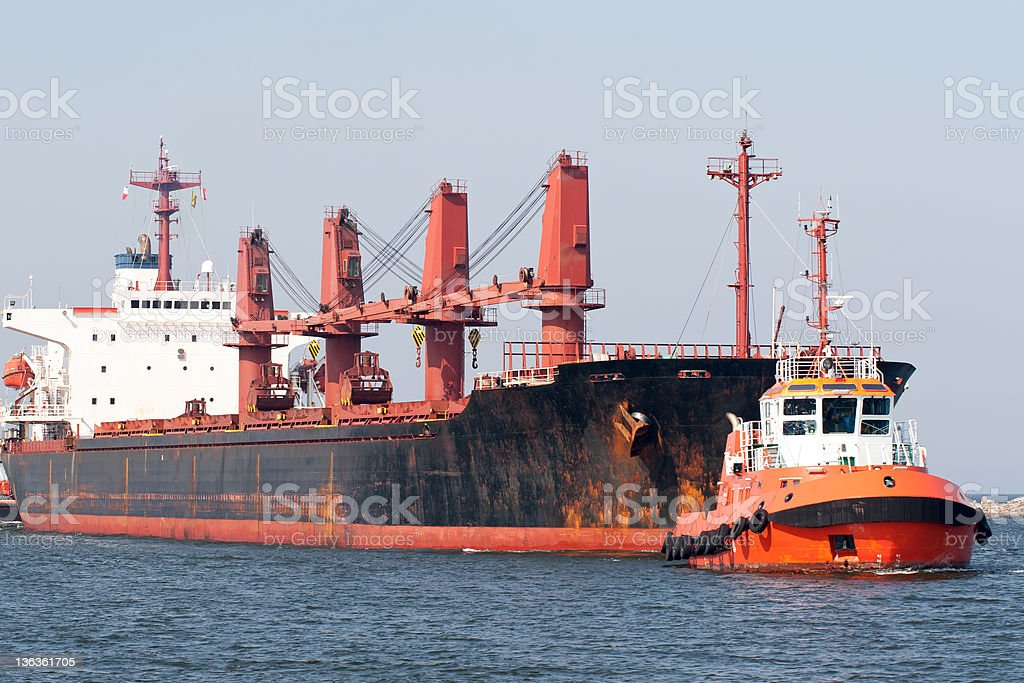 Big ship and tugboat assist. royalty-free stock photo