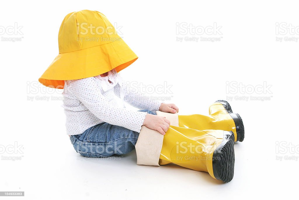 Big Shoe Children: Little girl in rain wear stock photo