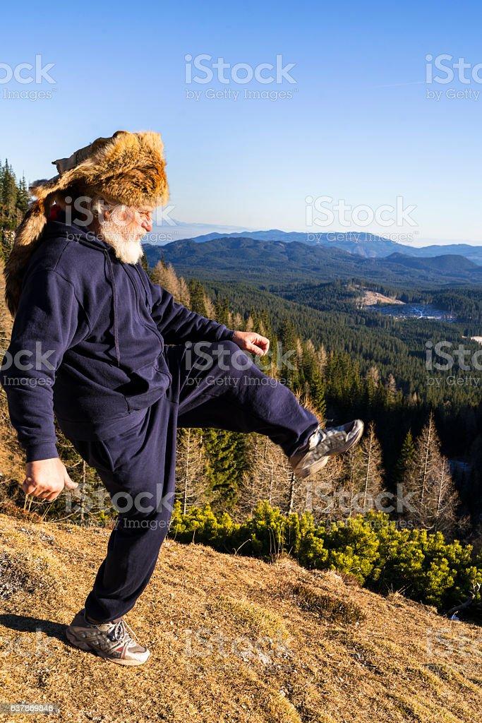 Big siep old senior with Kuchma on mountainest stock photo