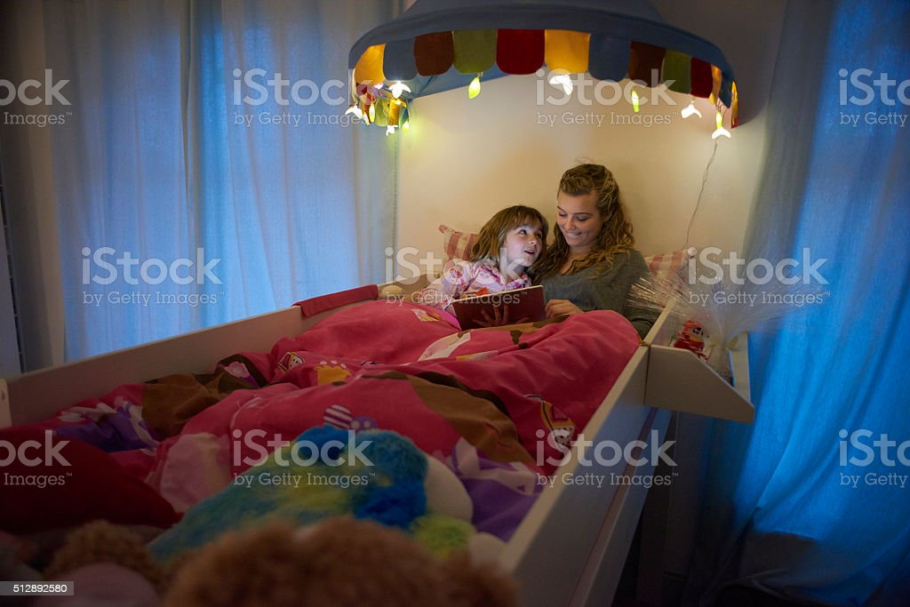 big sister bedtime booktime stock photo