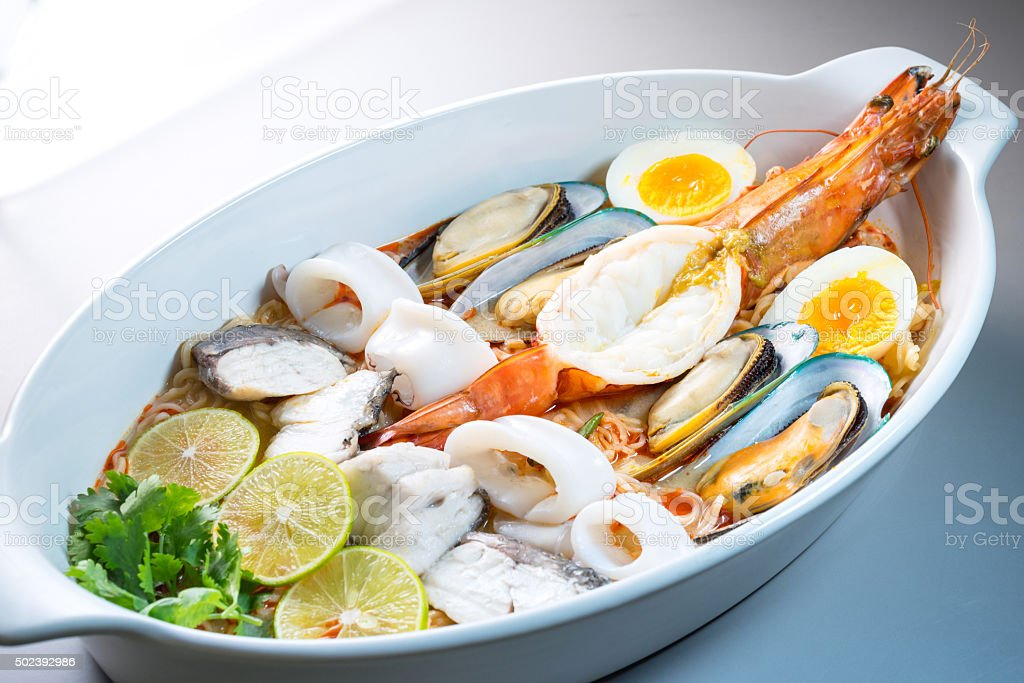 Big size bowl Spicy Seafoods Tom Yam Noodle stock photo