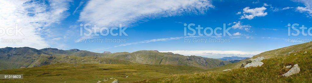 Big skies over green wilderness stock photo