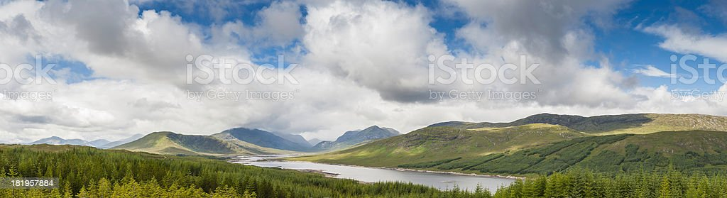 Big skies over Highland mountain loch and forest glen Scotland stock photo