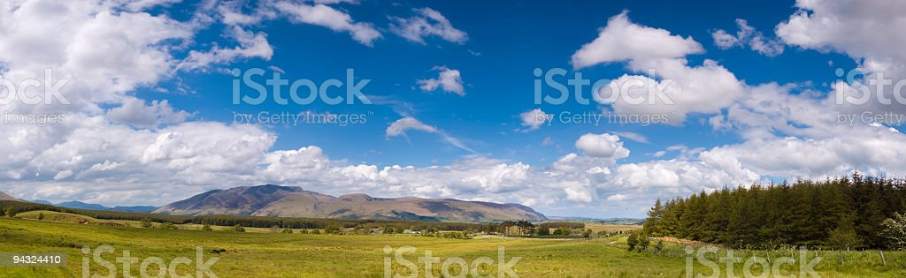 Big sky over forest, plain and mountain royalty-free stock photo