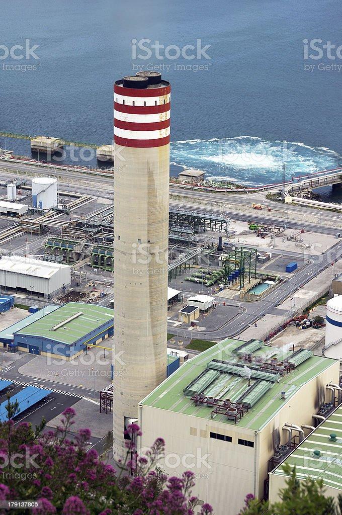 big smokestack of factory near sea royalty-free stock photo