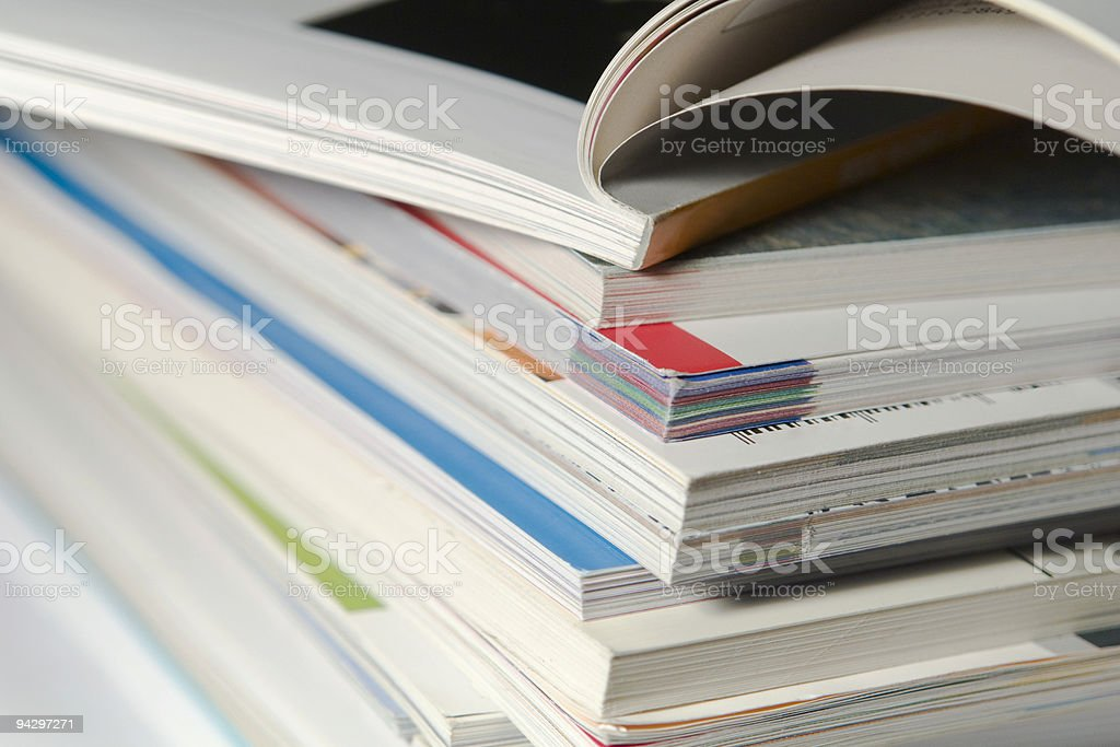 A big stack of already read magazines royalty-free stock photo