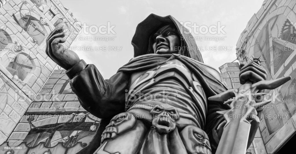 Big statue at a haunted house at a folk festival stock photo