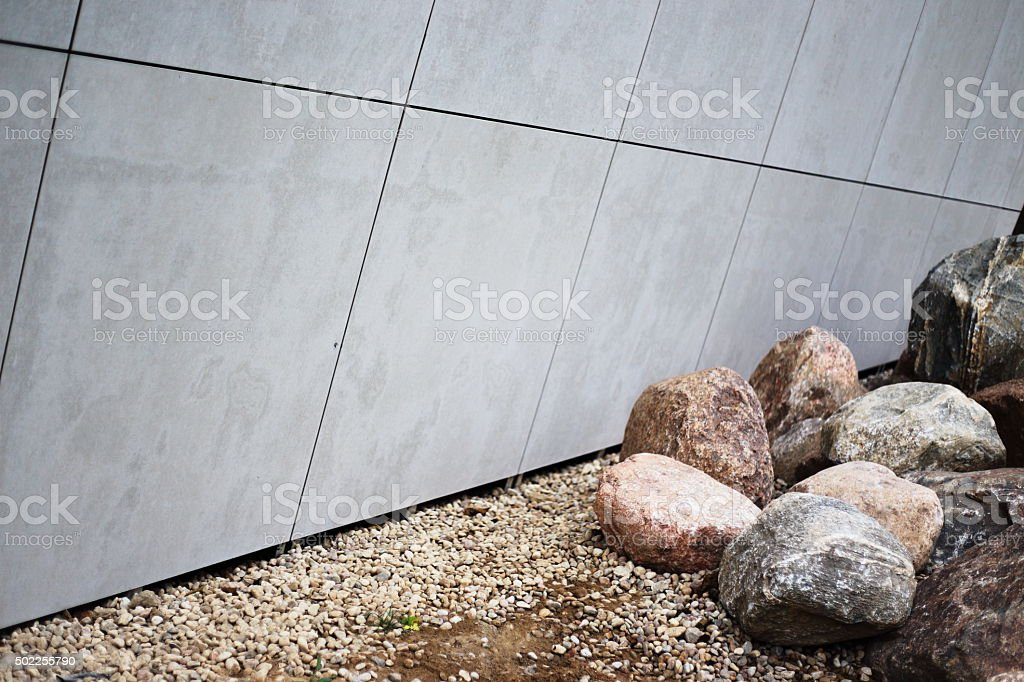 big stones and white sloped wall royalty-free stock photo