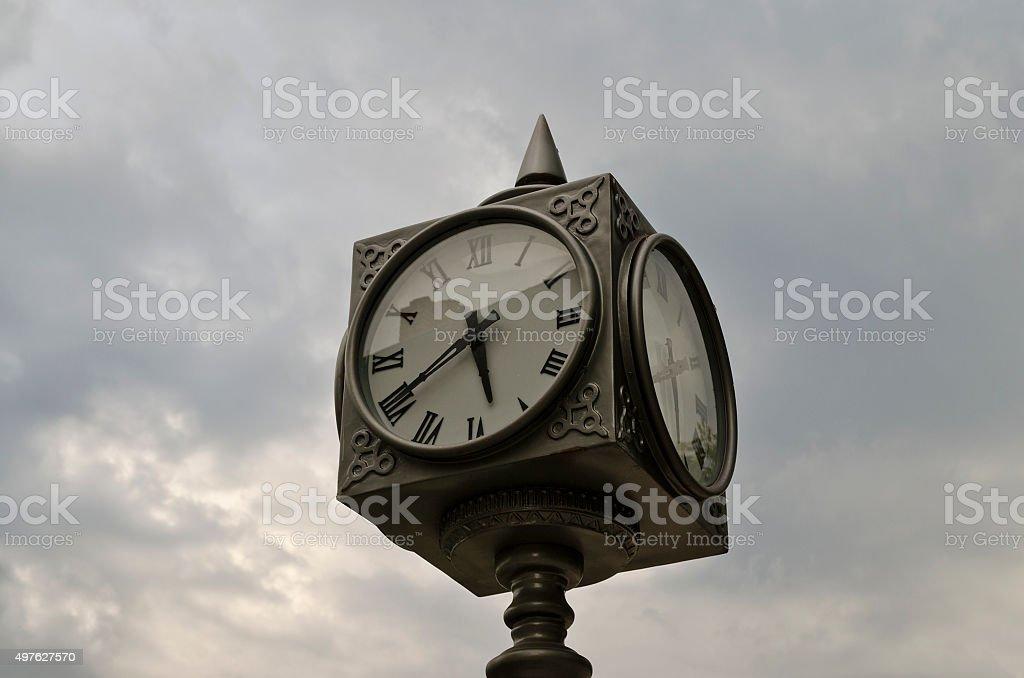Big street Clock on the blurred sky background stock photo