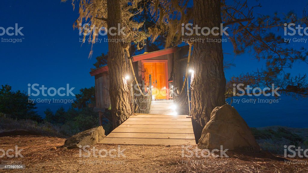 Big Sur tree house at sunset stock photo