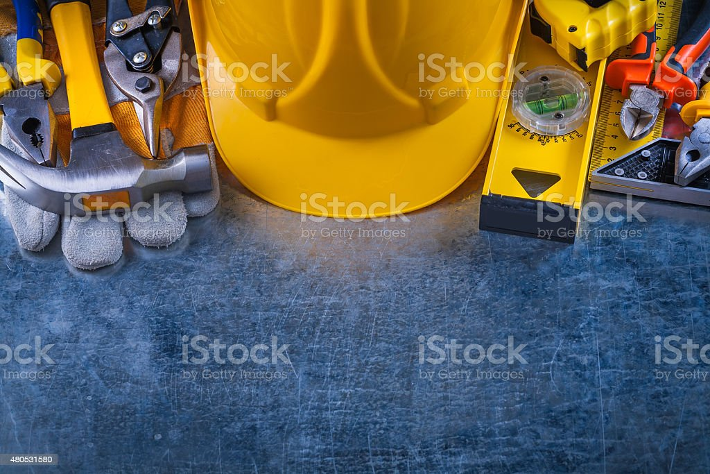 Big toolset on scratched vintage metallic background constructio stock photo