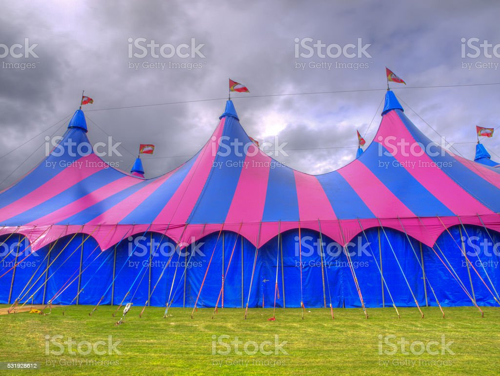 Big top circus tent on a field stock photo